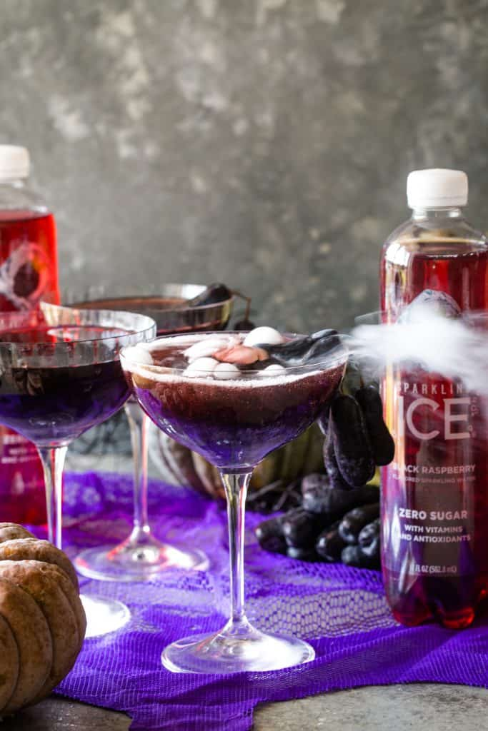 halloween vodka cocktails with sparkling ice in back