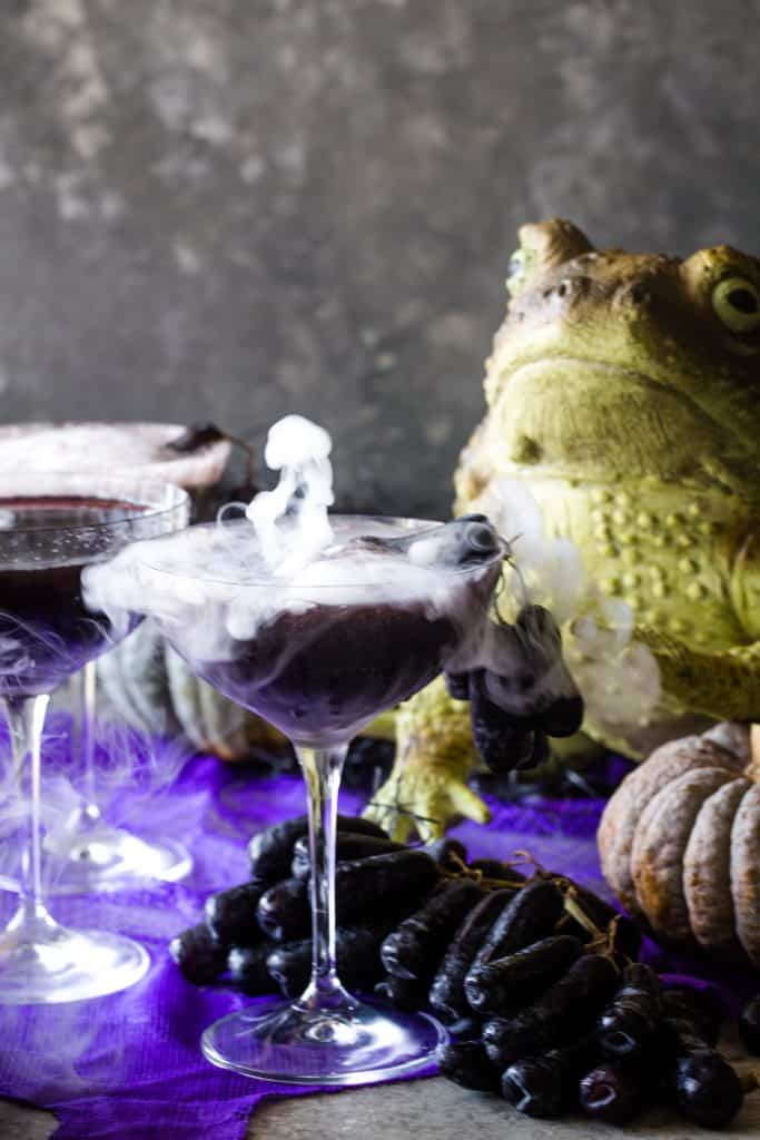 smoking cocktail with frog in background