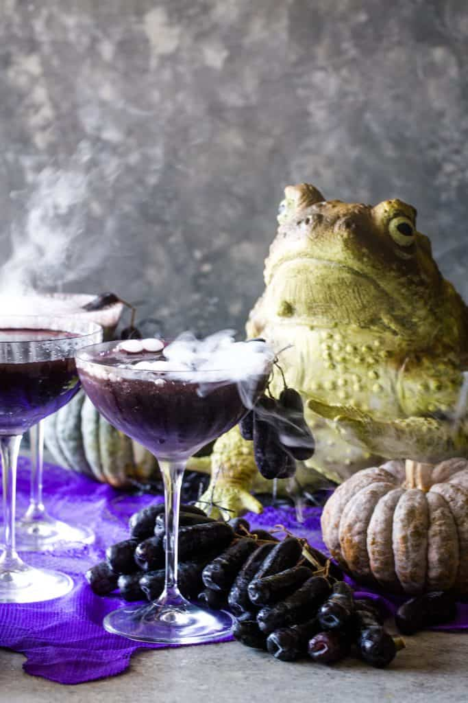 smoking cocktails on grey background with frog in background