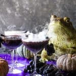 shot with smoking cocktails with frogs and pumpkins in background